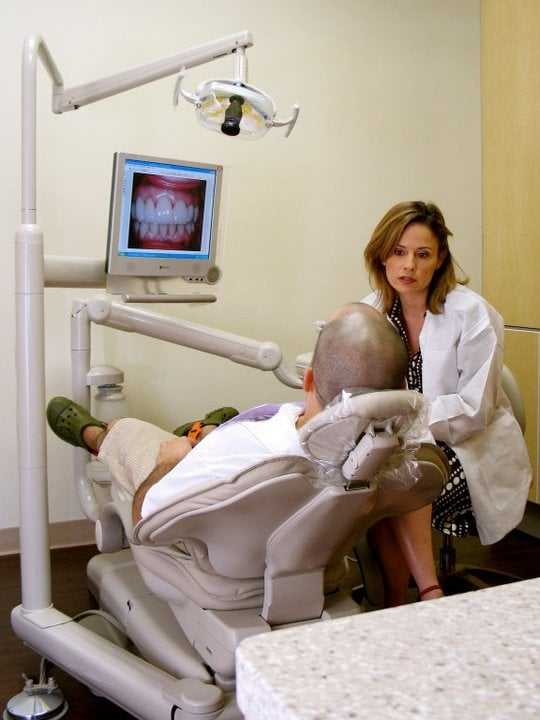 Dr. Garcia talking to a patient in an operatory at Alexandra Garcia, DDS.